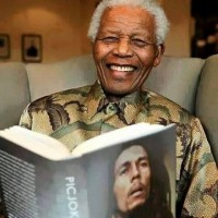Mandella reading about bobmarley and feeling irie bobmarley71 birthday celebrationhellip